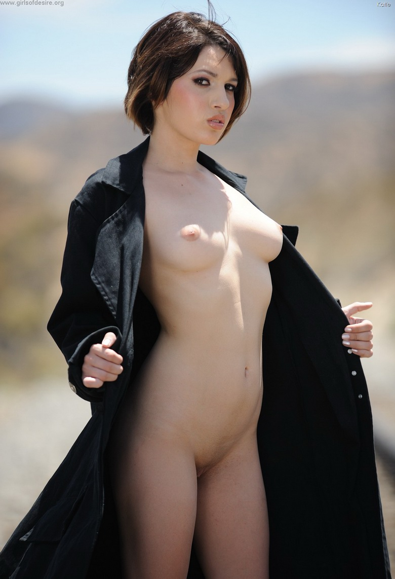 american coed Katie flashing her pussy near a railway track #10