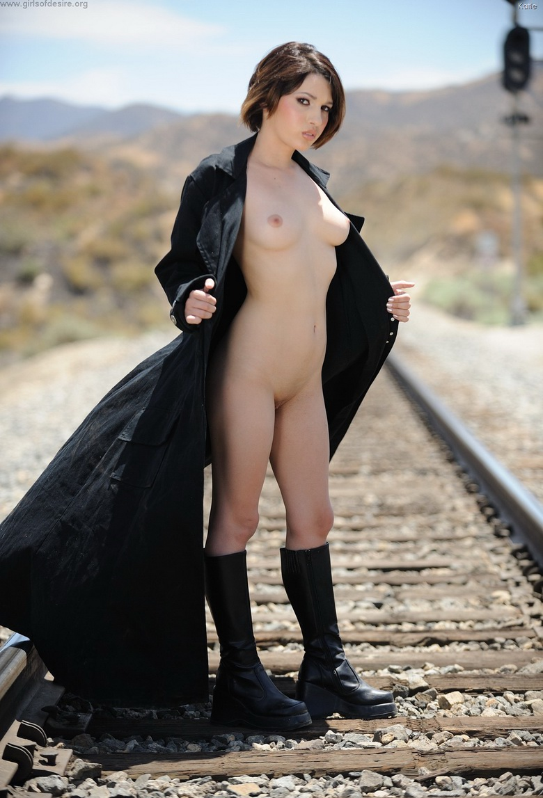 american coed Katie flashing her pussy near a railway track #3