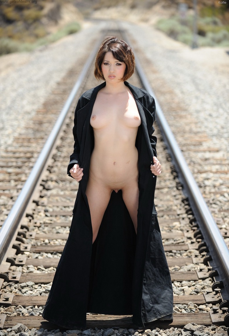 american coed Katie flashing her pussy near a railway track #1