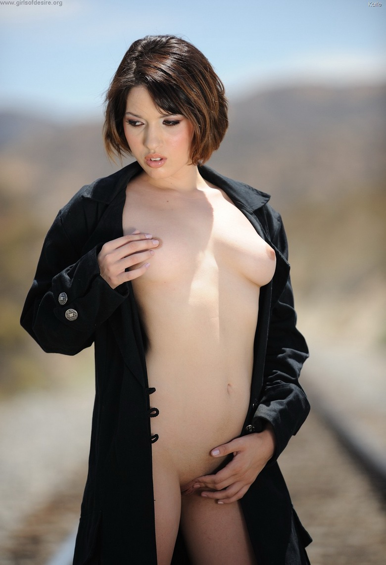 american coed Katie flashing her pussy near a railway track #11