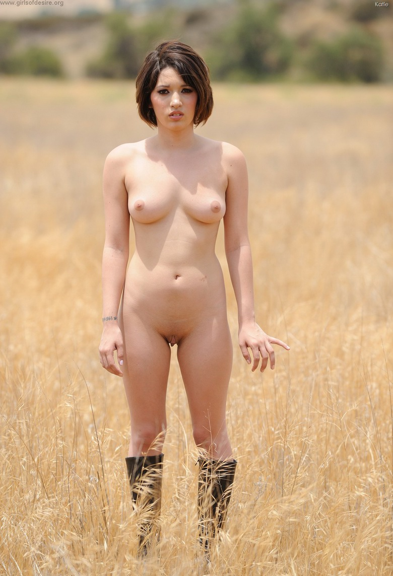 american coed Katie flashing her pussy near a railway track #5