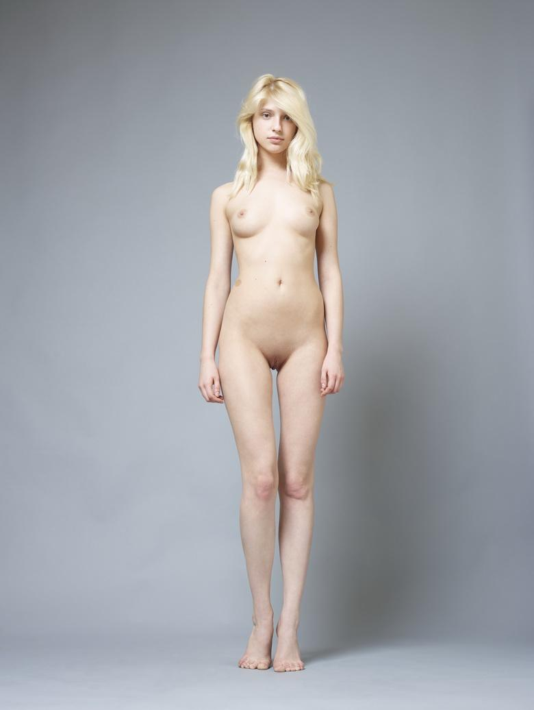 a tall slender athletic blonde is a bit shy but finally shows herself fully naked from hegre art
