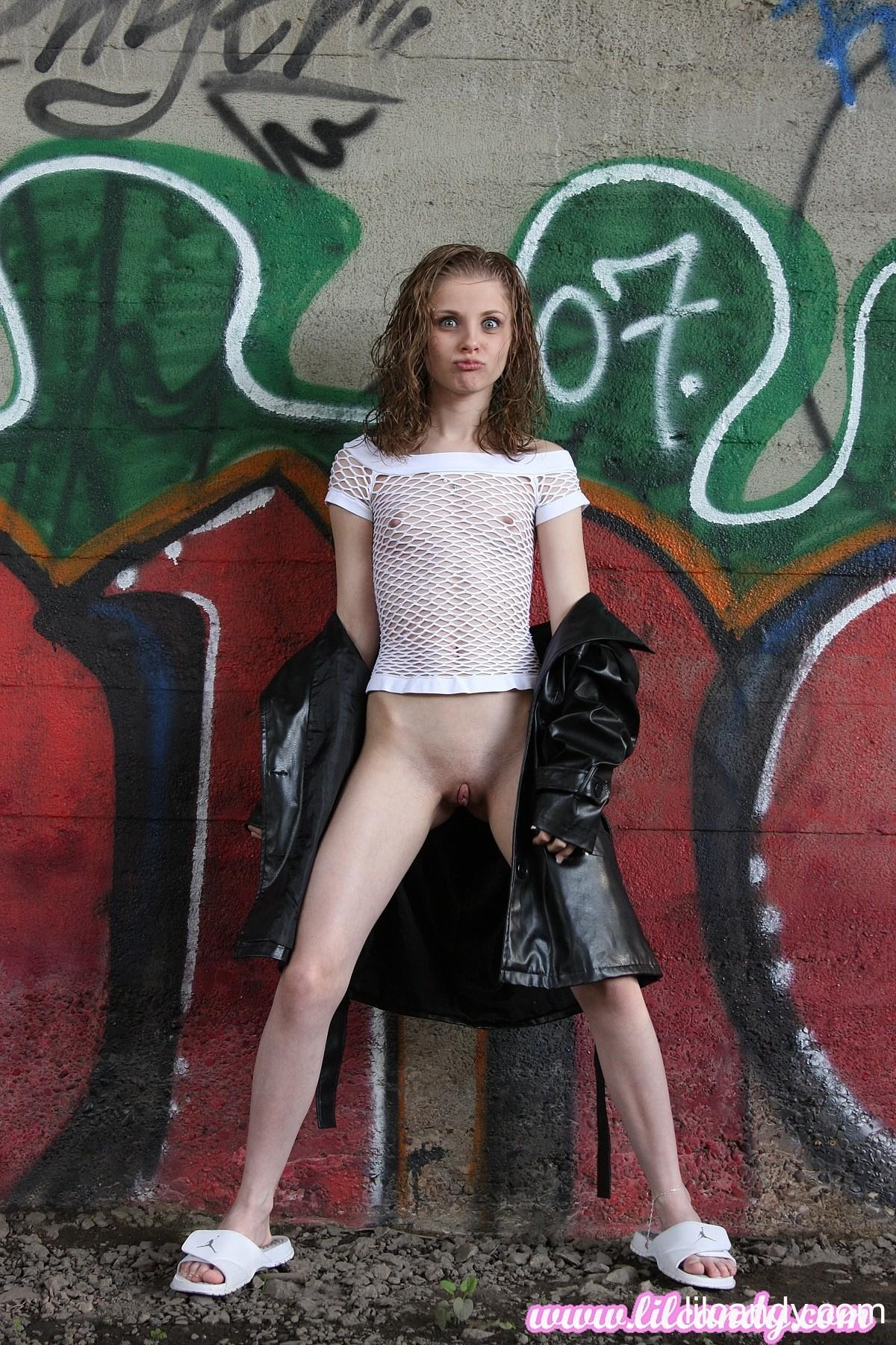 lilcandy is wearing a leather jacket and flashes her pantyless pussy in closeup #3