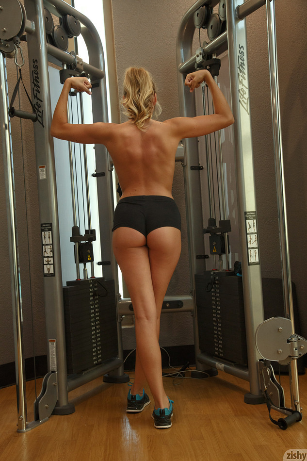 Sbusty portive sweetheart teasing a bit her slender slit and tits at the gym #1