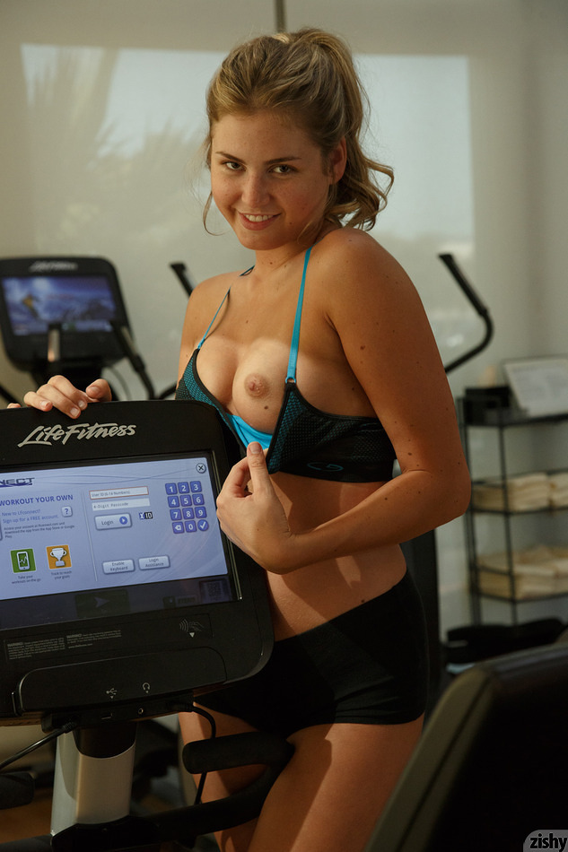 Sbusty portive sweetheart teasing a bit her slender slit and tits at the gym #2