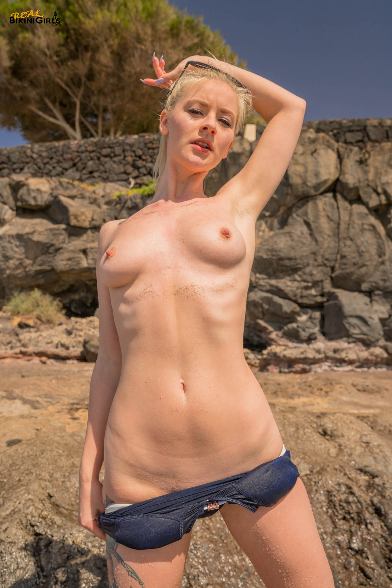 sexy short haired blonde with small tits having fun during beach vacation #1