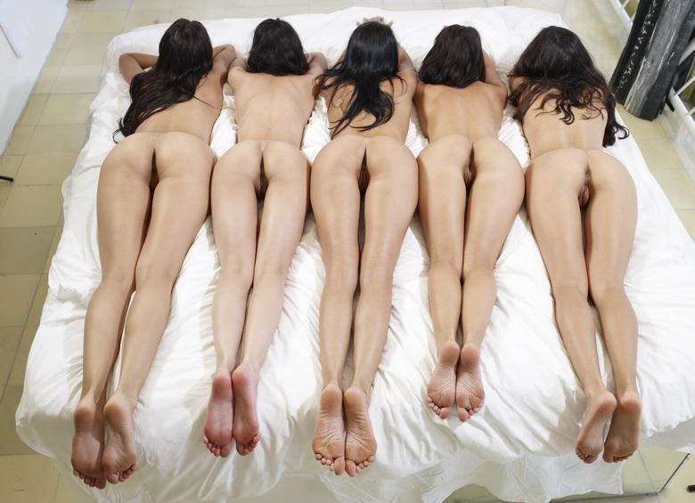 a group of female nudes is relaxing and taking a nap