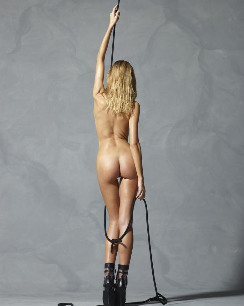 a tall blonde girl plays with a rope arround her naked athletic body in this hegre-art gallery update picture