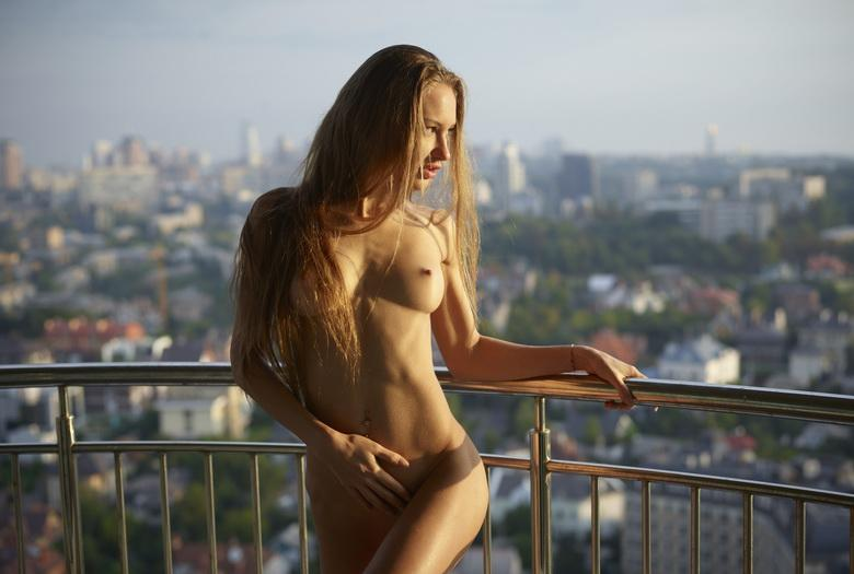 busty muse resides on top of the world picture