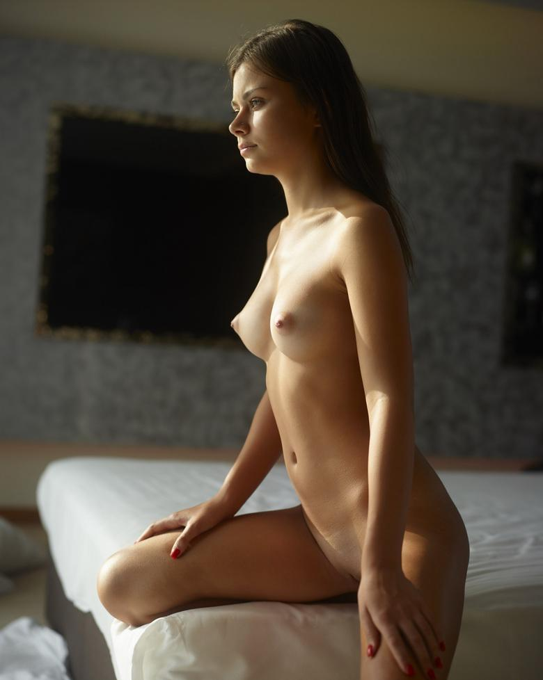 a young brunette with perfect figure spends a boring day in the hotel room picture