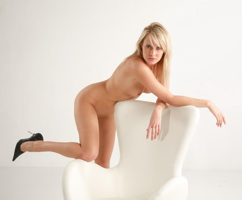 tall blonde posing naked on a vitra designer chair #3