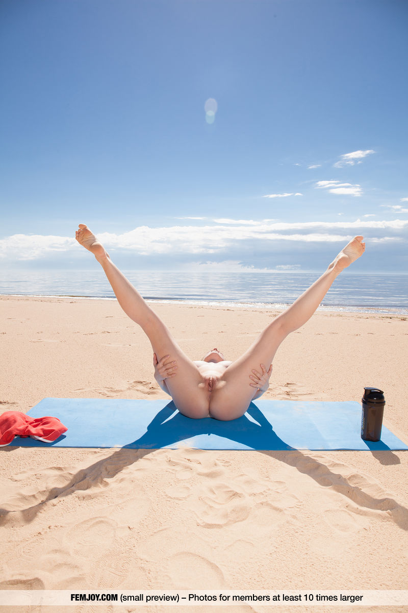 pretty sportive girl doing some hot naked yoga on the beach in sardegna #7
