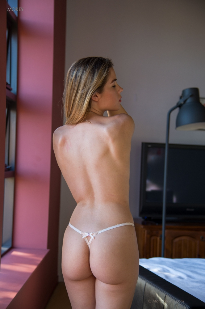 pretty blonde amateur model with nice back and ass posing in string tanga #5