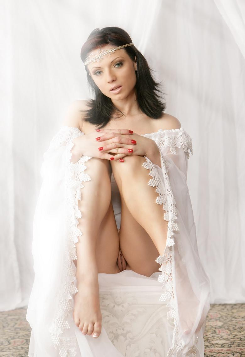 preety dark haired cutie takes of her wedding dress and flashes naked picture 3