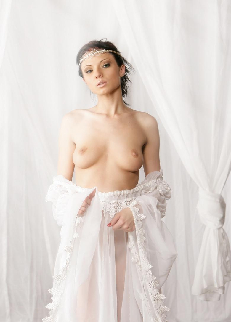 preety dark haired cutie takes of her wedding dress and flashes naked picture 4