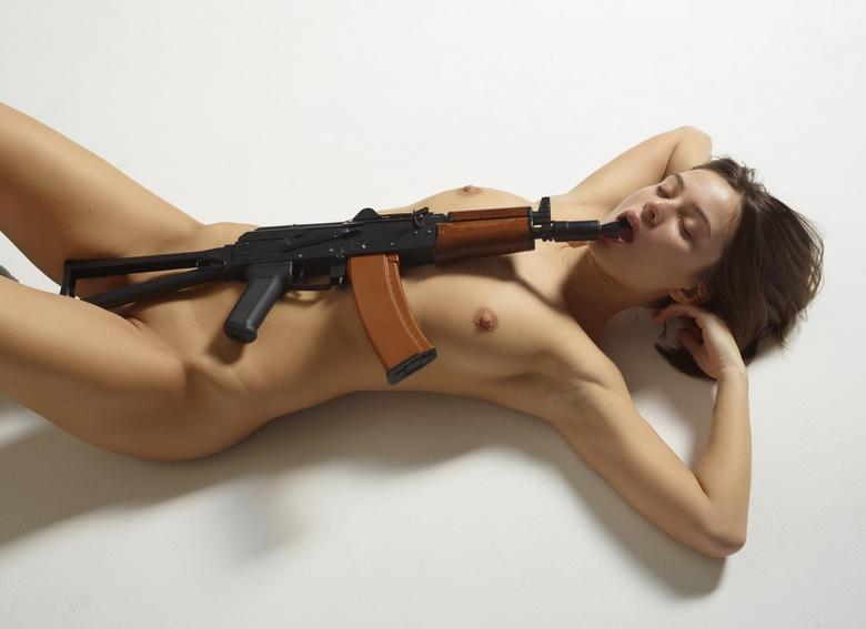 sexy athletic girl playing with an ak 47 picture 3