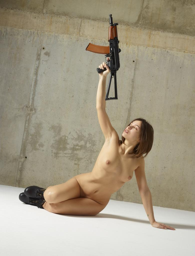 sexy athletic girl playing with an ak 47 picture 9