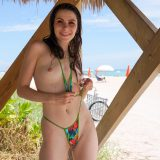 skinny girl taking off her micro bikini to show her closed little snatch picture 9