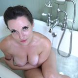 busty lady fullfilling her wet daydreams inside a bubble bath picture 9