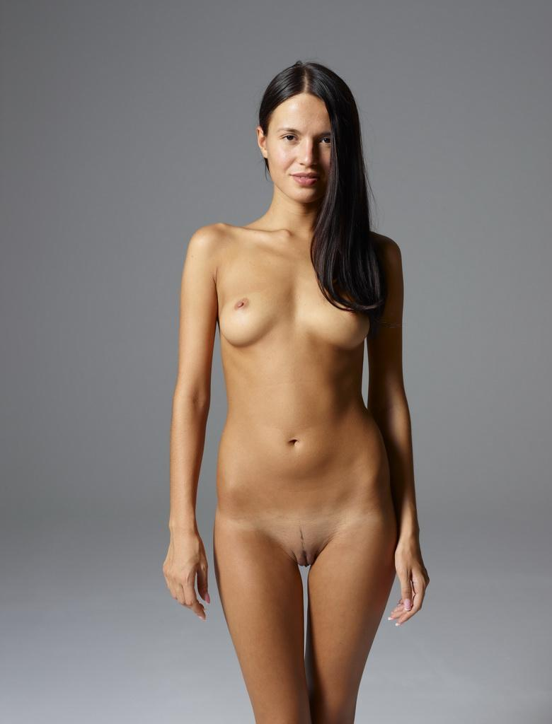 fully nude athletic girl doing a pose inside the hegre model studio picture 2