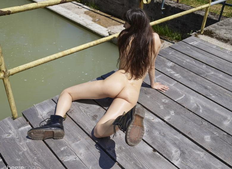 skinny nude girl does some exercise outdoors picture 2