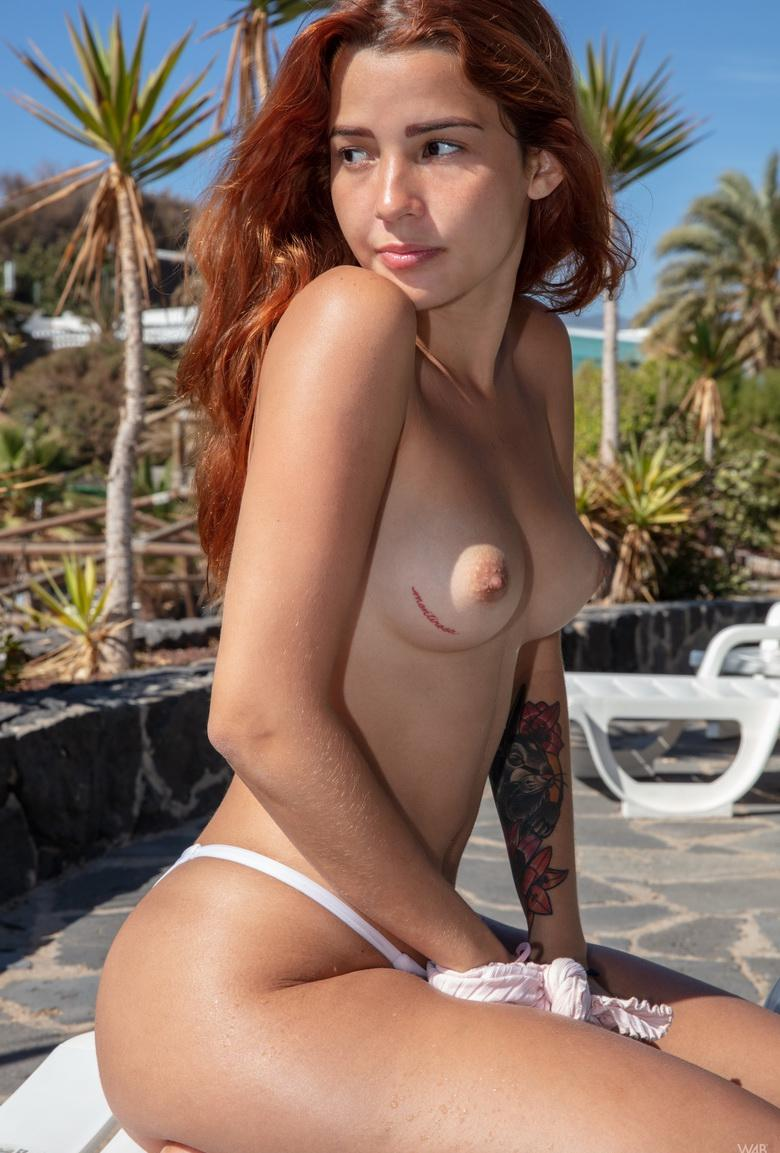 little nixen relaxing bare nacked at the luxury hotel pool picture 2