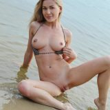 superb water sports nixen crouching down fully naked at the beach picture 13