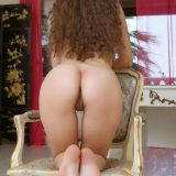curly brunette exposing her sweet pie from the backsite picture 14