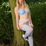 cutie with a small butt posing in the forrest picture 3