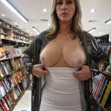 sexy mature lady flashing inside the book store picture 10