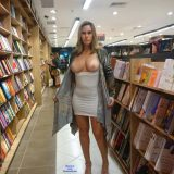 sexy mature lady flashing inside the book store picture 6