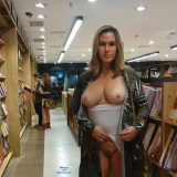sexy mature lady flashing inside the book store picture 3