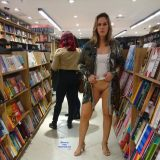 sexy mature lady flashing inside the book store picture 9
