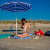 sunbathing nudist chick with admirable cameltoe picture 5