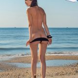 sunbathing nudist chick with admirable cameltoe picture 3